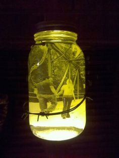 blaine made me this for xmas :) DIY. fill an antique mason jar with a photo and olive oil. (blaine got a new mason jar and spray painted it a rusty brown color, added a little barbed wire and put in on a lava lamp base)