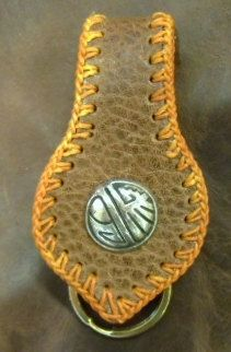 brown leather key ring fob with decorated button by G2P. $8.99, via Etsy.