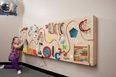 Ideas for interactive Sensory Wall. Would be fairly nice for workers to have more that keeps the toddler age busy without so many toys. Less to have to be picked up, wiped down, etc. More sense of order in room. Practicality in budget big question. Sensory Wall, Sensory Rooms, Sensory Boards, Baby Sensory Board, Sensory Tubs, Autism Sensory, Tactile Activities, Infant Activities, Play Activity