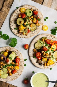 vege-nom:  Spicy chickpea and roasted veggie pitas / Recipe sourceClick here for more vegan food inspiration!