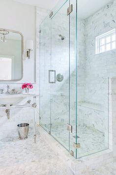 All marble bathroom + chrome fixtures + bench in the shower + marble mosaic floor + frameless shower door + half wall shower + lucite vanity legs | The Pink Pagoda