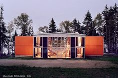 "The 12 Container House is a custom prefabricated house created from 12 recycled shipping containers. This ""T-shaped"" 2-story summer home features floor to ceiling windows, concrete floors, two fireplaces and radiant in-floor heating."