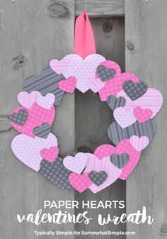 Dig through your scrapbook supplies stash or head to the craft store to pick out some fun Valentine's Day paper for this easy-to-make scrapbook paper hearts wreath. | SomewhatSimple.com