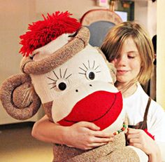 Sock Monkey Hug - http://www.midwayvillage.com/wordpress/exhibits/the-missing-link-socks-monkeys-and-rockfords-industrial-past/