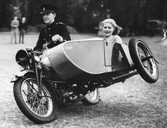 ca. 1938, UK — A man drives television presenter Jasmine Bligh during a trick cycling demonstration where the motorcycle and sidecar tip over to one side. — Image by © Hulton-Deutsch Collection/Corbis