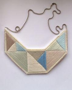 Geometric bib necklace silvery grays and blues embroidered triangles dramatic design. $65.00, via Etsy.