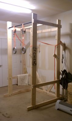 Build your own power rack. This guy has some crazy diy ideas for the garage gym.