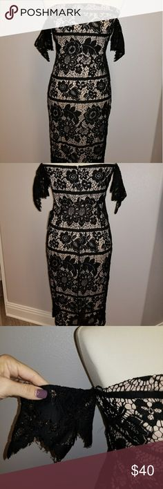 Black & Nude Lace Off the Shoulder Dress Gorgeous and elegant off the shoulder nude dress with black lace overlay slightly longer than the nude liner. Never been worn. Perfect for a Christmas or NYE party! Express Dresses Midi