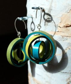 5 Paper Jewelry Artists. One example: Kimberlee Mason of PULP by Rogue Theory made these rolled paper Orbium earrings.