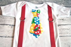 The Very Hungry Caterpillar Inspired Tie & Suspenders Onesie - Made To Order -0-3M through 24M. $18.00, via Etsy.