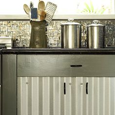 Innovative Materials:  This homeowner customized her cabinets by using corrugated metal on the face of her cabinet doors.