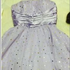 Short prom dress Style is puffy.the fabric is tulle. I only wore it once and is in good condition. Dresses Mini