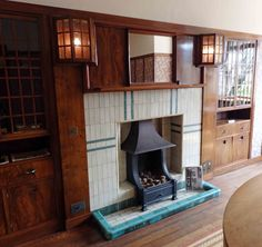 Dining Room of 78 Derngate, I love the Mackintosh lights either side of the fireplace