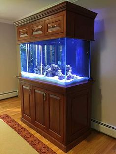 This is a solid cherry aquarium stand I built for a customer of mine.