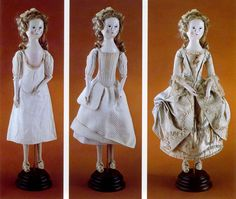 Dolls showing the layers of a woman's clothing. Shift on the left. Stays, quilted petticoat and pocket in the middle. Gown on the right. The pocket was reached through a slit in the top petticoats.