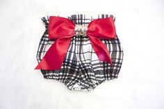 """These are the most adorable high waist bloomers! Perfect for the up coming fall months. They are made from the softest and most beautiful black and white modern plaid cotton. These are limited edition due to the availability of the fabric. They fit just under babies belly button. The bow is on the behind and has a beautiful gold sequin material in the center. There are also four faux glitter Dot """"buttons"""" on the front.These pair beautifully with tights or leg warmers/b..."""