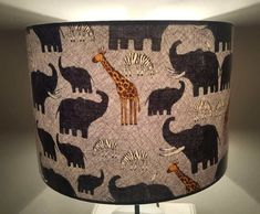 Handmade Lampshade ideal for a kids bedroom. This jungle animals themed shade in a soft palette of greys and mustard is perfect for a baby nursery or little boys bedroom. Available in a variety of sizes. Handmade Lampshades, Modern Lamp Shades, Jungle Animals, Image Shows, Shades Of Blue, Kids Bedroom, Light In The Dark, Mustard, Safari