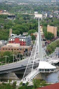 The Provencher Bridge across the Red River in Winnipeg, Manitoba, Canada ~ links downtown Winnipeg with St. Boniface, a Winnipeg community across the Red River. Beautiful Vacation Spots, Beautiful Places, Great Places, Places To See, Riding Mountain National Park, Cable Stayed Bridge, Discover Canada, Western Canada, Pedestrian Bridge
