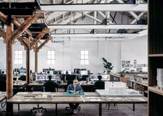 Chinese studio Naturalbuild has created an office and event space in a Shanghai warehouse that previously belonged to Huang Jinrong – a notorious 1930s underworld figure