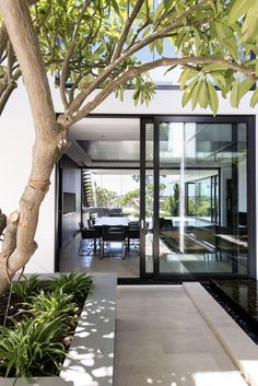 An inviting light and bright exterior walk way designed and built by Urbane Projects, Perth.
