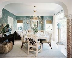 wallpaper, in a good way // blue green wall paper, airy furniture, classic elegance
