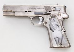 A World War II Polish Model 1935 Radom (German occupation production) semi automatic pistol.  This unique pistol was captured by an American soldier during the war and modified with transparent.aircraft plexiglass grips.