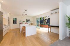 modern white kitchen by KMD Kitchens Auckland