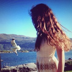 Summer beach curls wavy hair brunette girl