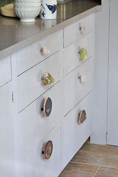 Add a bit of glam to cabinets and drawers by turning geodes, sea glass, or minerals into hardware.