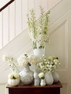 GORG. ARRANGEMENTS  assortment/grouping of floral arrangements on a table rather than one.
