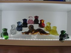 Heisey Animal Mold: TIGER Collection in Clear by Imperial Glass, Light Blue by Dalzell Viking Glass, Cobalt, Pink, Ruby Red by Dalzell Viking Glass, Red Slag by Mosser Glass, Yellow Mist by Dalzell Viking Glass, Yellow Mist Satin or Frosted by Dalzell Viking Glass, Jade by Imperial Glass, Emerald Green and End of Day Slag (Amber Slag) by Imperial Glass