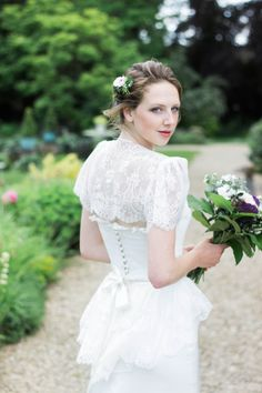 Fair Phantom Lace Dress from Chanticleer, Blue Ribbon Collection.  www.chanticleerbrides.co.uk    Hair by Stacey from Updoo.  Cake - Cotswold Finest Cakes  Flowers - Abbey Meadow Flowers  Model - Jenny Stewart
