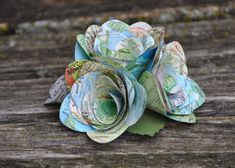 This lovely little bunch of map roses is just the thing to put on top of any cake! Made from vintage atlases, each rose is carefully cut and put together by hand. There are little leaves added for accents. You get to choose if you want a 4 inch, 6 inch, or 8 inch cake topper.