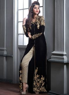 Featuring black and beige velvet embroidered suit beautified with elegant resham and zari work on the jacket.It is paired with matching bottom and chiffon duppata.This suit can be stitched upto size 42. For stitching enquiries, please email us at customercare@hunardesigns.com   |…