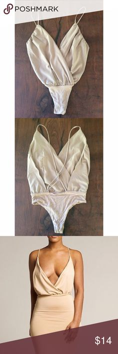 """EUC Sexy V Neck Wrap Bodysuit Top In excellent condition, worn once and had been clean tan color bodysuit in size medium. Adjust ale straps and snap buttons closured on the bottom. No flaws. Measure about 25"""" length without the straps, 13.5"""" waist. Has stretch to the bodysuit so probably can fit a large. ❌Model pic is similar style and for visual purposes only. Actual item is the first two pics above❌No modeling or trades. Open to offers and bundling deal. Thank you‼️Not Nastygal‼️ Nasty Gal…"""