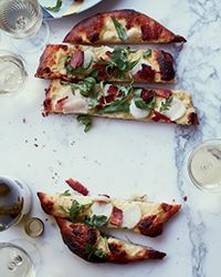 A quick, garlicky béchamel stands in for crème fraîche and cheese in this luxurious white pizza.  Slideshow: More Pizza Recipes