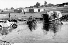 A 'Raupenschlepper' or caterpillar tractor hauls an artillery piece across a river. JUN 22 1944 Operation Bagration – the Red Army begins its revenge