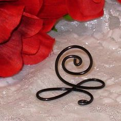 Infinity table number holder wedding table number stand set of 6 black infinity bow wire name place cards wire table number holders black table number greentooth Image collections