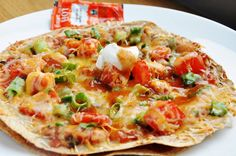 Mexican Tortilla Pizza. Love this! Especially great with homemade salsa, but just as good with a good salsa out of a jar. Quick, easy, vegetarian dinner. Fairly healthy especially if you go easy on the refried beans and cheese. Try it!