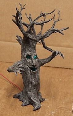 I could make these with all of the dead branches in my yard. Spray paint them black or silver.