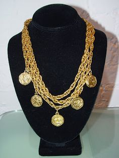 Chanel three strand rope necklace featuring one strand with antique looking CC medallion coins c 80s