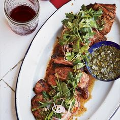 Coffee-Rubbed Strip Steaks with Chimichurri Sauce | This bright and fresh chimichurri is used twice: as a sauce for the steak and as a dressing for the accompanying herb salad.