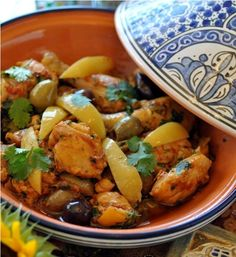 Chicken tangine with preserved lemons and olives. I've never tried tangine but it looks delicious!