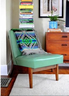 mint chair--maybe behind the sofa we need a small dresser for art supplies etc? Or a book tower with the bamboo thingy on top?
