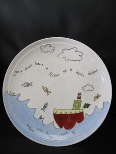 plate hand painted The Sea, a Boat and Fish for a child. $33.00, via Etsy.