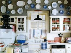 this is so effective - great way to display blue and white plates. more blue and white ideas here - http://decoratedlife.com/blue-white-decorating-videos/