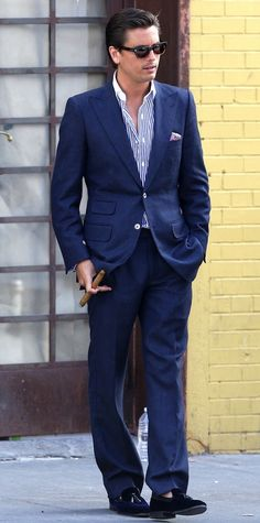 Scott Disick was spotted all suited up while out and about in the Meatpacking District in New York City. He was seen wearing a blue two button suit, a striped shirt, Arfango Velvet Quilted Tassel Loafers