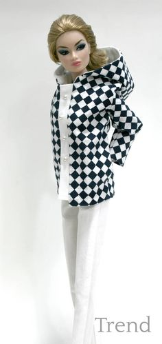 Hooded Jacket is made in a navy blue and white checked cotton. Jacket features side pockets and silver-tone faux buttons with snap closures. Pants are made in a white cotton with side pockets and a metal snap closure. Designed to fit Fashion Royalty and FR2 dolls. Doll & accessories