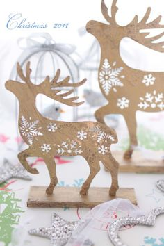 Laser cut snowflake patterned reindeer.