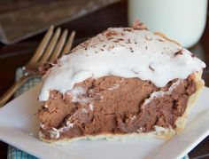 Creamy chocolate pie topped with whipped cream